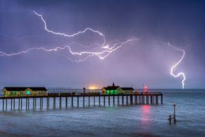 A fine art landscape photography print of a lightening Storm at Suffolk's Southwold Pier