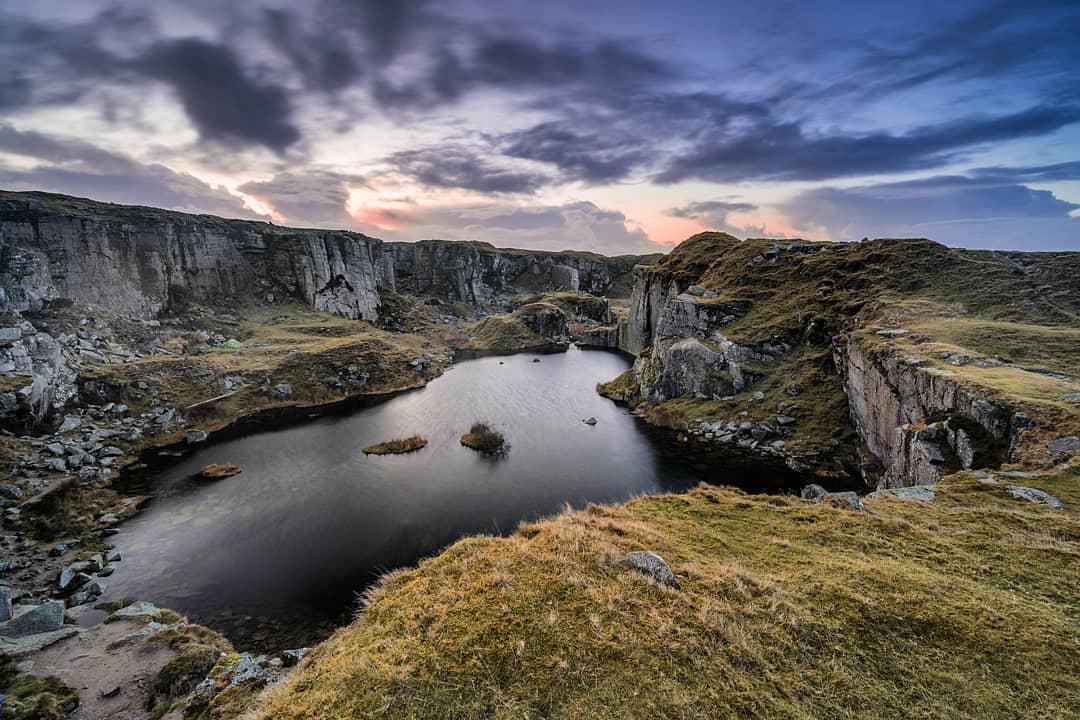 A fine art landscape photography print of a Dartmoor sunrise at Foggintor Quarry