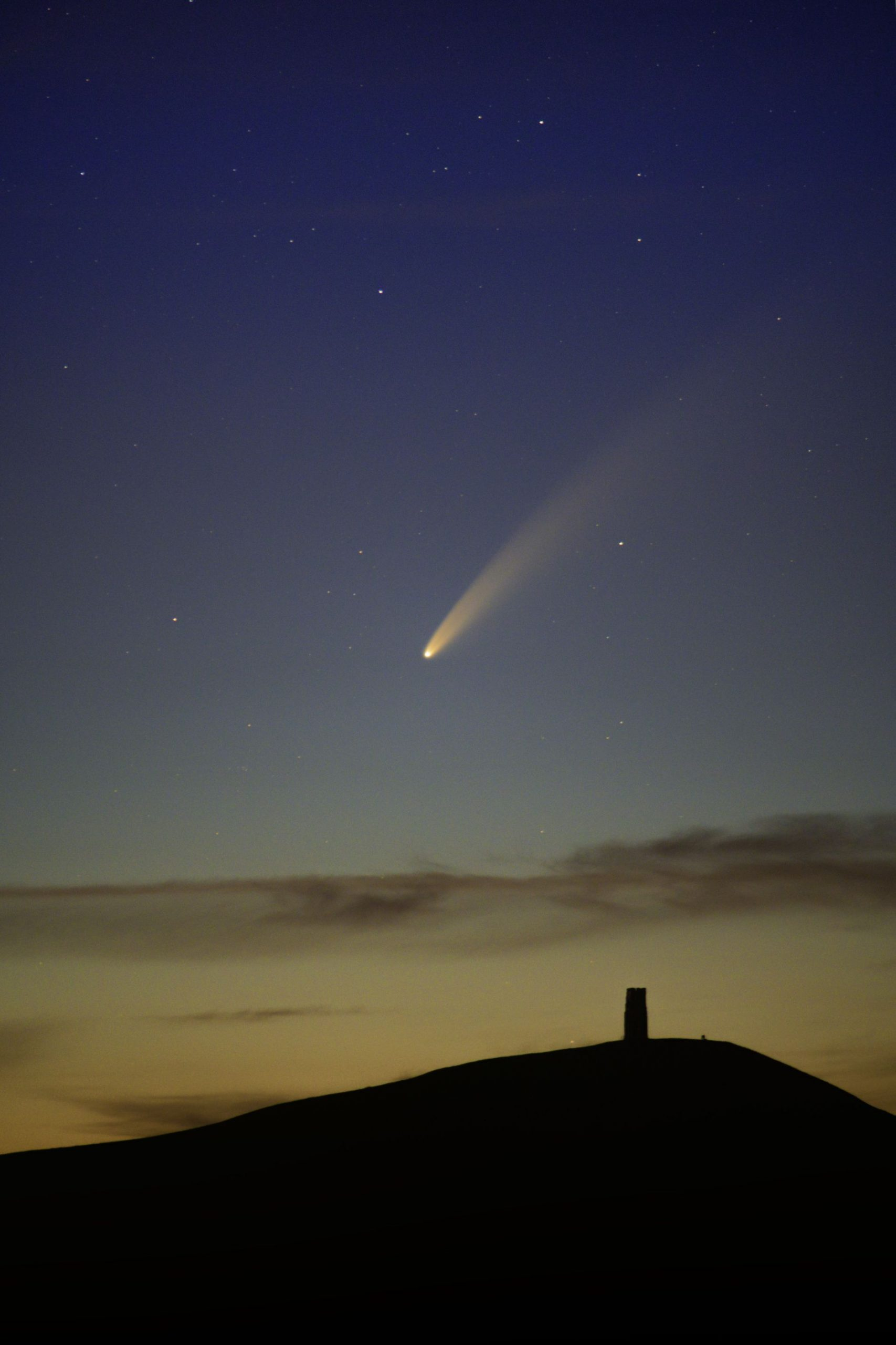 Print of Comet Neowise at golden hour at Glastonbury Tor UK